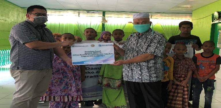 Jamkrindo Berbagi Sembako dan Santunan Anak Yatim Piatu di Bitung