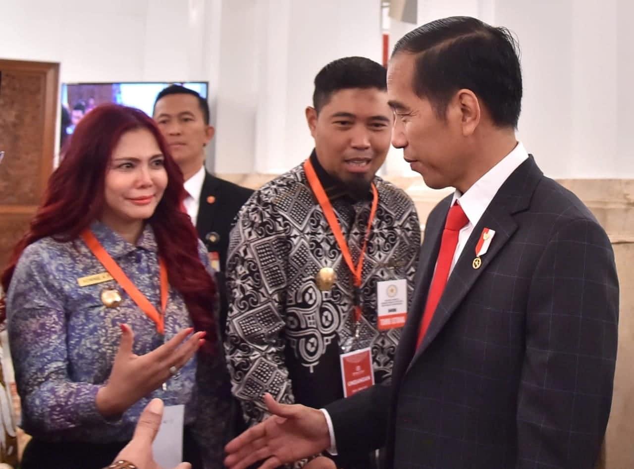 Bupati VAP Terima Penghargaan UHC JKN-KIS Award dari Presiden RI Jokowi